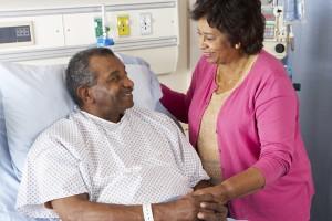 Senior Wife Visiting Husband On Ward